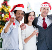 United business team drinking champagne to celebrate christmas — Stock Photo