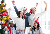 Nice business team punching the air to celebrate christmas — Stock Photo