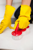 Close-up of a woman cleaning a bathroom's floor — Stock Photo