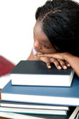 Bored student leaning on a stack of books — Stock Photo