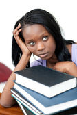 Upset student leaning on a stack of books — Stock Photo
