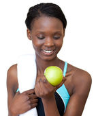 Young fitness woman eating an apple — Stock Photo