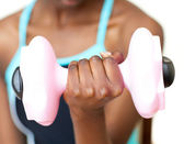 Close-up of a woman working out with dumbbell — Stock Photo
