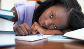 Exhausted Afro-American woman resting while studying — Stock Photo