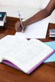 Close-up of a teen girl doing her homework — Stock Photo