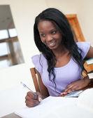 Beautiful young woman doing her homework — Stock Photo