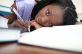 Tired young woman studying — Stock Photo