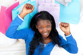 Cheerful woman punching the air in celebration after shopping — Stock Photo