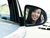 Brunette teen girl sitting in her car holding keys — Stock Photo