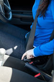 Close-up of caucasian woman putting seat belt — Stock Photo