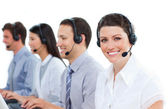 Positive customer service agents working in a call center — Stock Photo