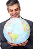 Mature businessman smiling at global business expansion — Stock Photo