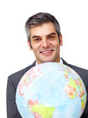 Charisatic businessman holding a terrestrial globe — Stock Photo