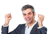 Uomo d'affari gioioso aria nella celebrazione di punzonatura — Foto Stock