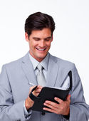 Smiling businessman holding an agenda — Stock Photo