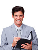 Charismatic businessman holding an agenda — Stock Photo