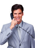Smiling male executive tangle up in phone wires — Stock Photo