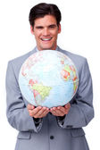 Charismatic businessman holding a terrestrial globe — Stock Photo