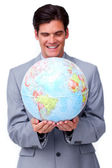 Assertive businessman smiling at global business expansion — Stock Photo