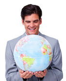 Confident businessman smiling at global business expansion — Stock Photo