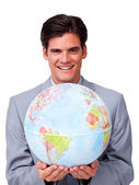 Self-assured businessman holding a terrestrial globe — Stock Photo