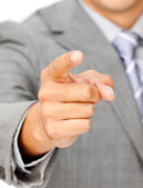 Close-up of a businessman pointing at the camera — Stock Photo