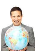 Attractive businessman holding a terrestrial globe — Stock Photo