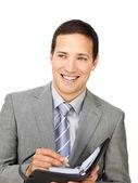 Atrakcyjny młody biznesmen posiadania programu — Zdjęcie stockowe