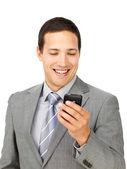 Charismatic businessman sending a text — Stock Photo