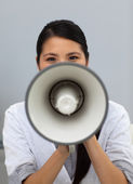 Confident ethnic businesswoman yelling instructions — Stock Photo