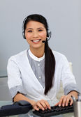 Ethnic customer service representative with headset on — Stock Photo