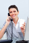 Cheerful business woman on phone — Stock Photo