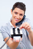 Brunette business woman on phone searching for the index — Stock Photo