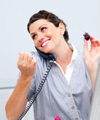 Charming woman on phone painting her nails — Stock Photo