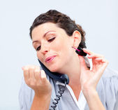 Close-up of businesswoman on phone painting her nails — Stock Photo