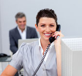 Pretty business woman on phone — Stock Photo