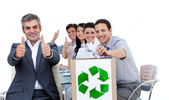 Cheerful business showing the concept of recycling — Stock Photo