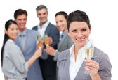 Positive business team toasting with Champagne — Stock Photo
