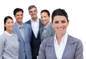 Happy businesswoman with folded arms standing with his team — Stock Photo
