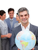 Ambitious manager and his team holding a terrestrial globe — Stock Photo