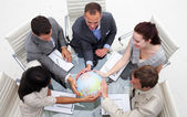High angle of business holding the world — Stock Photo