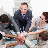Close-up of multi-ethnic business team with hands together — Stock fotografie