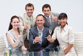 Business team celebrating a success with champagne in the office — Stock Photo