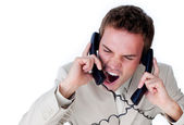 Frustrated businessman tangle up in phone wires — Stock Photo