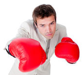 Competitive businessman beating the competition — Stock Photo