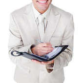 Close-up of a businessman making notes on his diary — Stock Photo