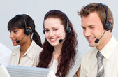 Beautiful woman working with her team in a call center — Stock Photo