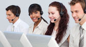 Ethnic woman working with her team in a call center — Stock Photo