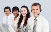 Smiling with a headset on working in a call center — Stock Photo