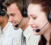 Portrait of with a headset on in a call center — Stock Photo